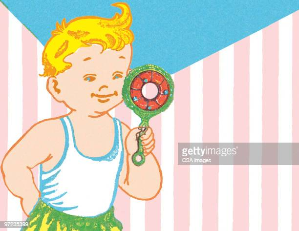 boy with rattle - toddler stock illustrations