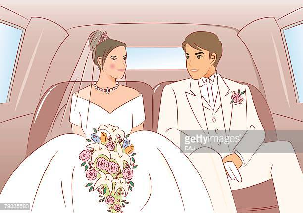 Bridal couple sitting on seats of limousine, front view