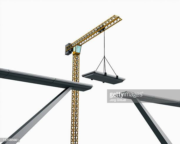a bridge being assembled by a crane - brücke stock-grafiken, -clipart, -cartoons und -symbole