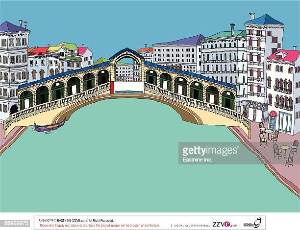Bridge on river by buildings