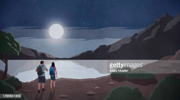 bright full moon over couple hiking at tranquil mountain lake - exploration stock illustrations