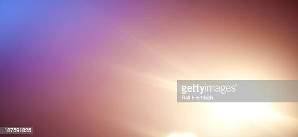 a bright glowing spot on a tranquil background - focus on background stock illustrations