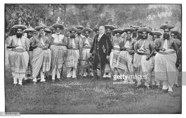 british man with group of indian men in india - british era - british culture stock illustrations