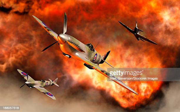 british supermarine spitfires bursting through the explosive flames of their recent kill. - world war ii stock illustrations