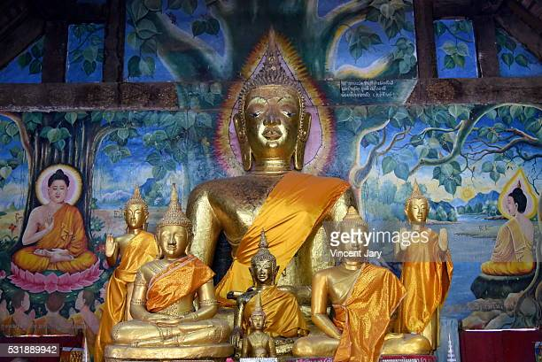 Buddha statues and wall paintings Aham Outama Thany temple Luang Prabang Laos