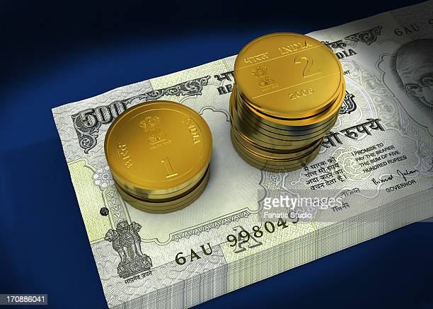 bundle of indian currency notes with stack of coins - cash flow stock illustrations, clip art, cartoons, & icons