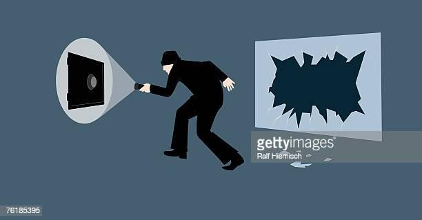 a burglar holding a flashlight and walking towards a combination safe - flashlight stock illustrations, clip art, cartoons, & icons