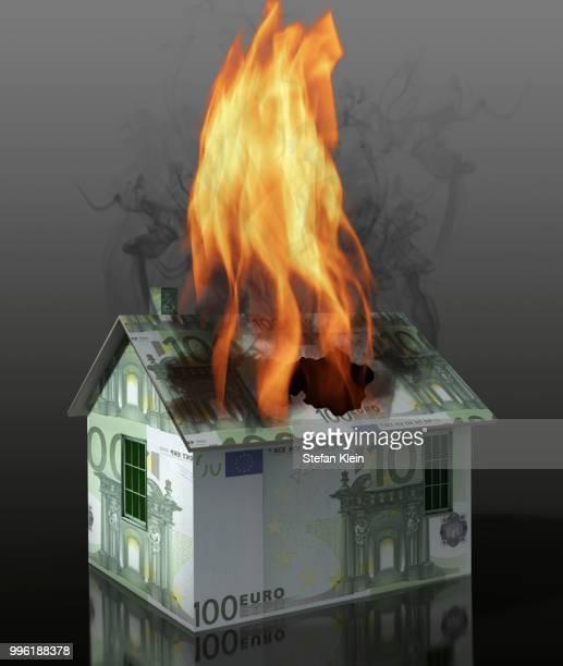 burning house made of euro notes illustration - european union euro note stock illustrations, clip art, cartoons, & icons