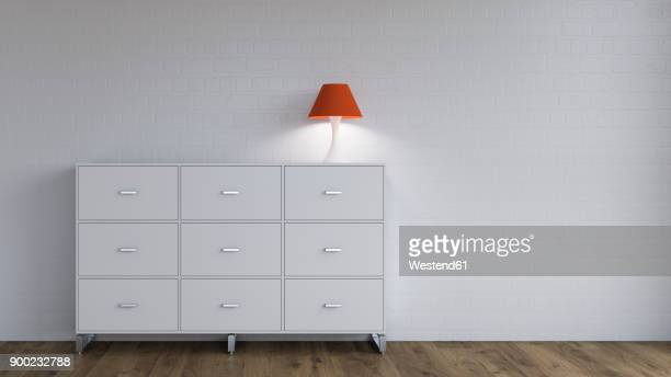 Burning lamp on sideboard