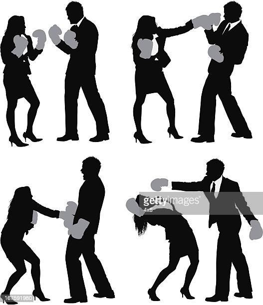 business executives fighting in boxing gloves - fighting stance stock illustrations, clip art, cartoons, & icons