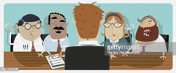 Business People Interviewing a Businessman
