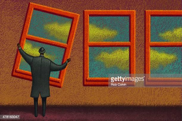 Businessman adjusting window