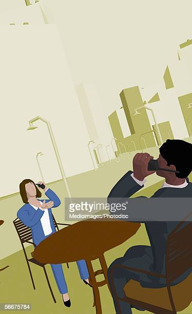 Businessman and a businesswoman sitting in a cafe and talking on cordless phones
