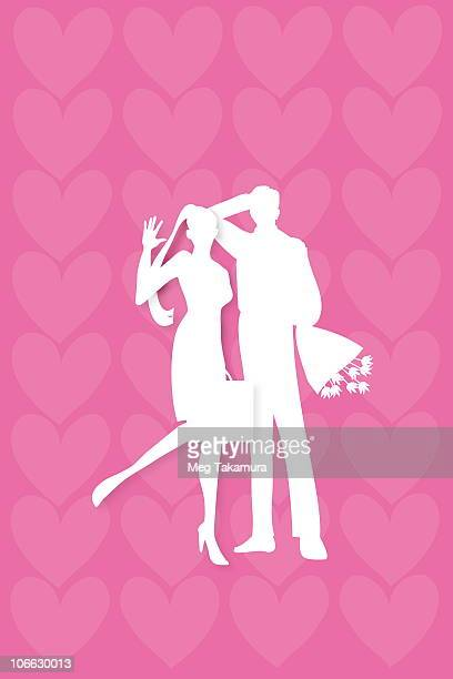 Businessman and businesswoman standing in front of heart shape background
