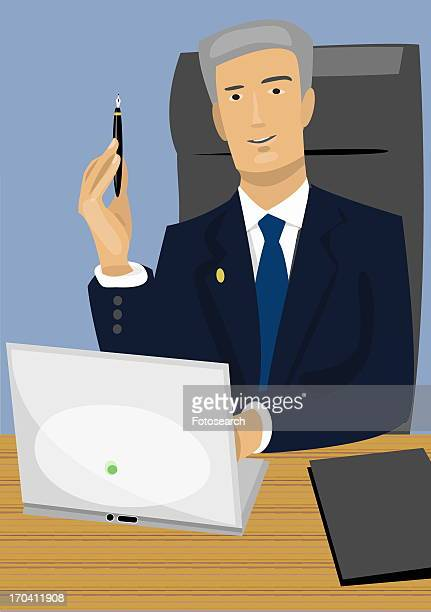 Businessman at desk with laptop