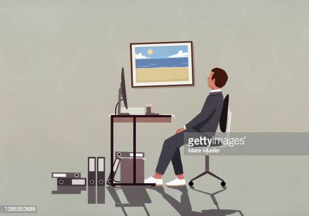 businessman at office desk looking at photograph of beach on wall - ideas stock illustrations