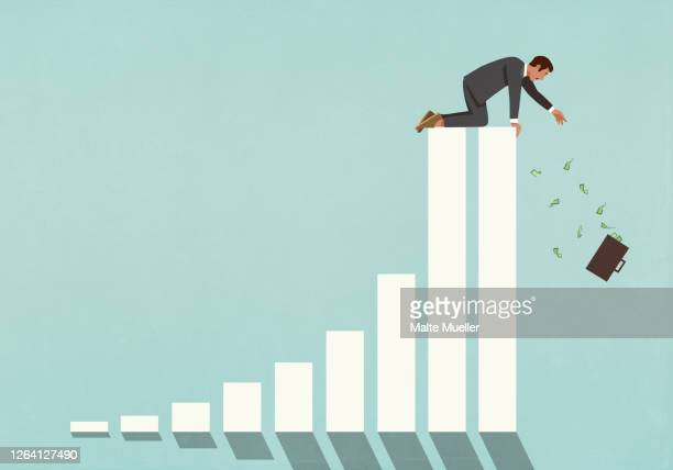 businessman at top of bar graph reaching for falling briefcase of cash - danger stock illustrations