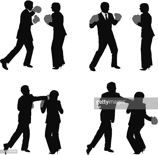 Businessman boxing with businesswoman