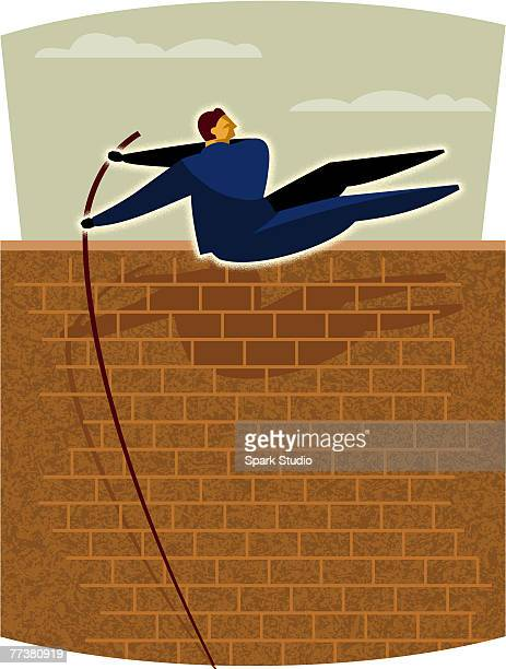 A businessman doing the pole vault