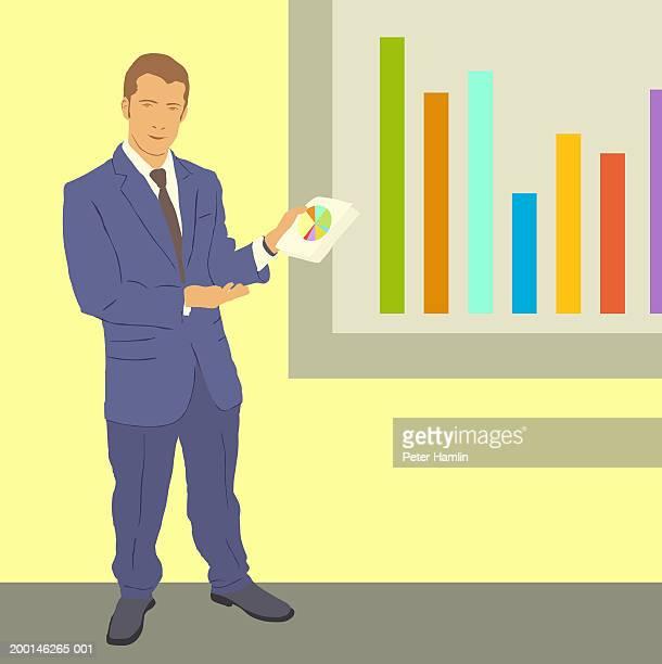 Businessman giving presentation using graphs