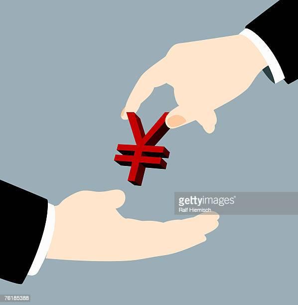 A businessman handing a yen sign to another businessman