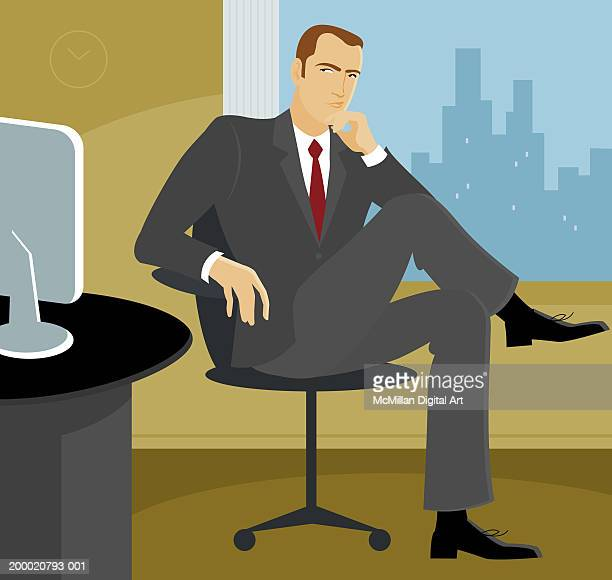 Businessman in deep thought sitting in office