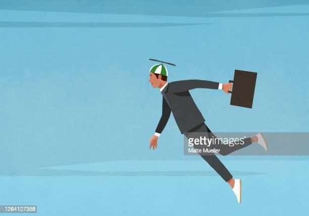 businessman in propellor hat flying in sky - full length stock illustrations