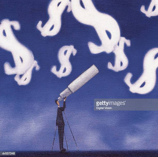 Businessman looking at dollar signs through a telescope