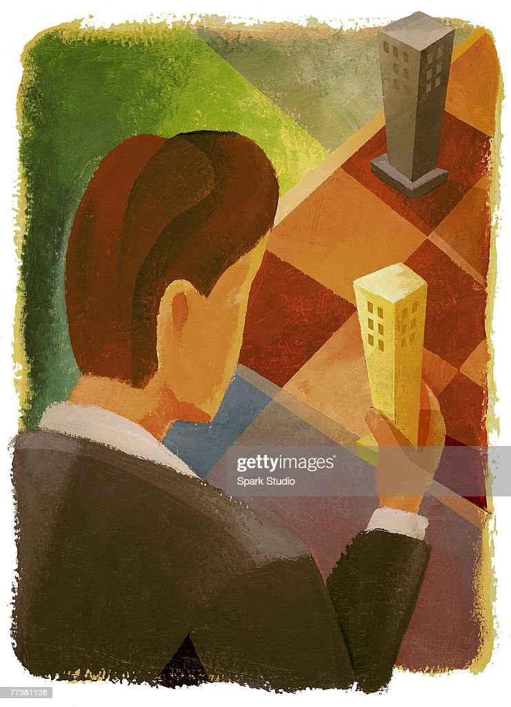A businessman moving miniature buildings on a checkered board : Stock Illustration