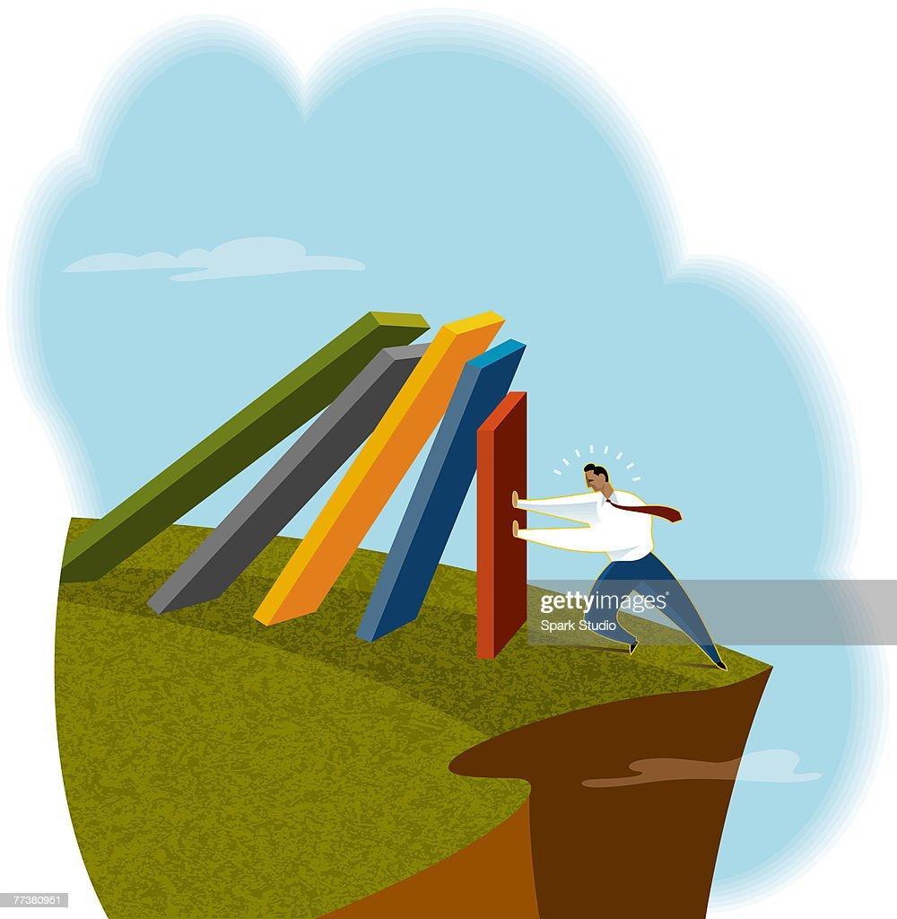 A businessman pushing a row of falling walls : Illustration