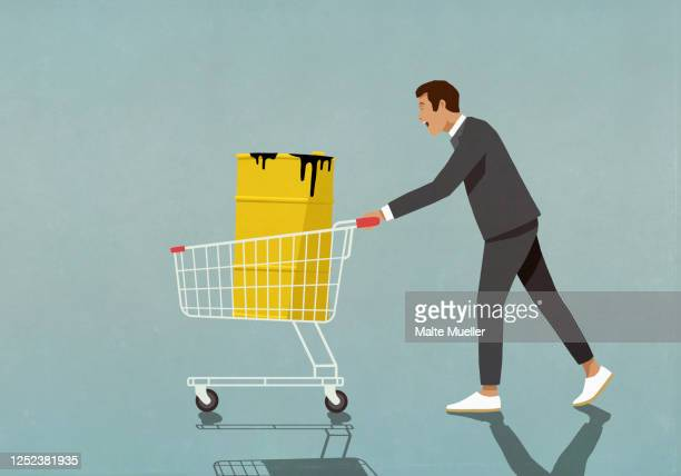 businessman pushing oil barrel in shopping cart - men stock illustrations