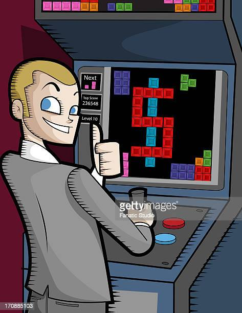 Businessman showing thumbs up at video arcade