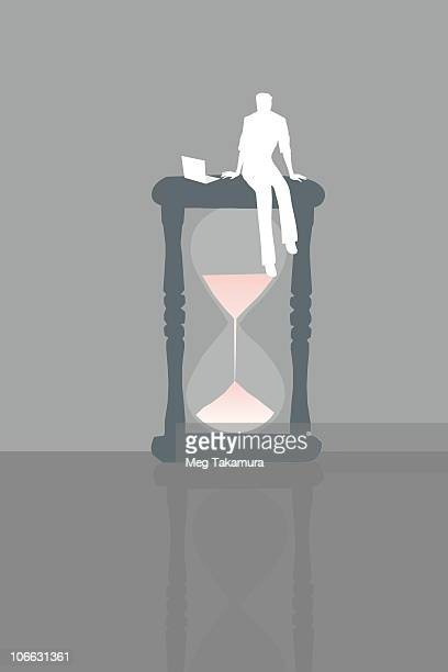 illustrations, cliparts, dessins animés et icônes de businessman sitting on top a hourglass - impatient