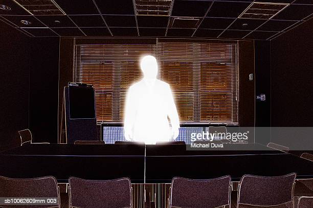 businessman standing beside conference table - digital enhancement stock illustrations