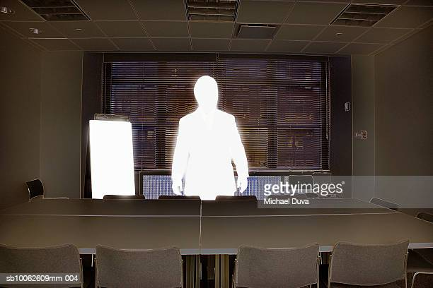 businessman standing beside conference table - meeting stock illustrations