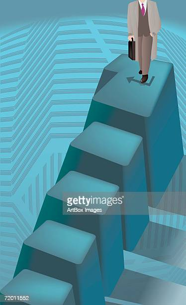Businessman standing on the top of stairs