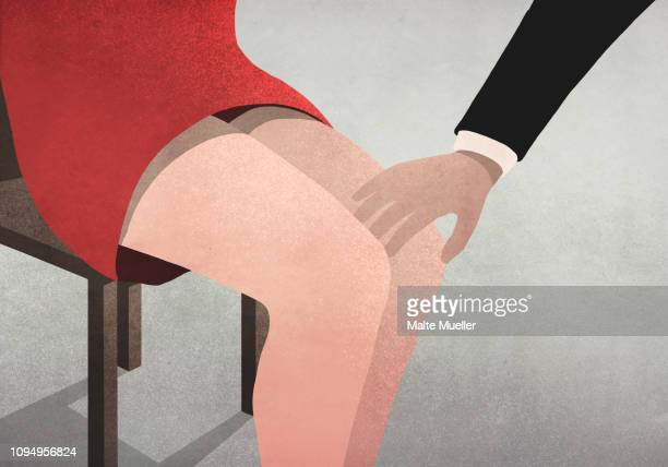 Businessman touching womans knee