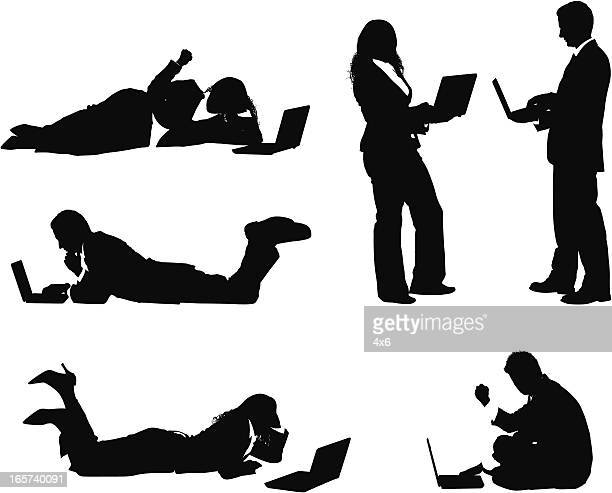 businessmen and businesswomen working on laptops - lying on front stock illustrations, clip art, cartoons, & icons