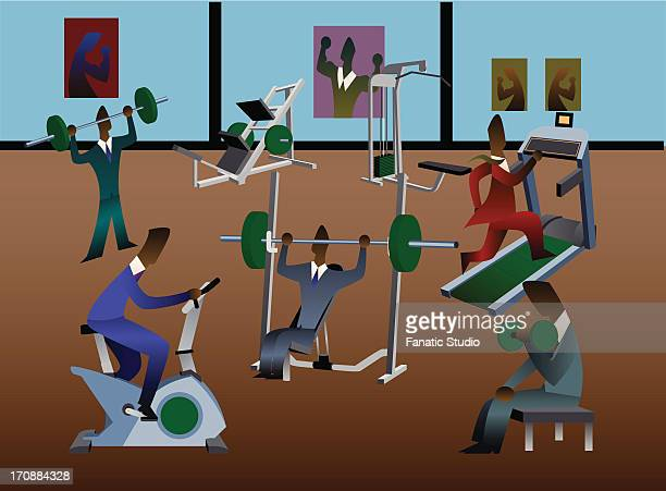 Businessmen exercising in a gym