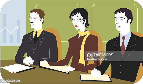 Businesssmen and businesswoman sitting around conference table