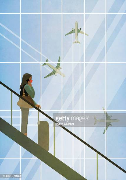 businesswoman in face mask riding descending escalator at airport - journey stock illustrations