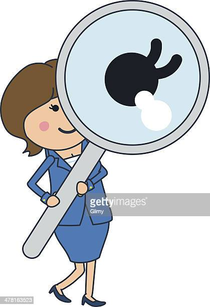 A businesswoman looking through a large magnifying glass
