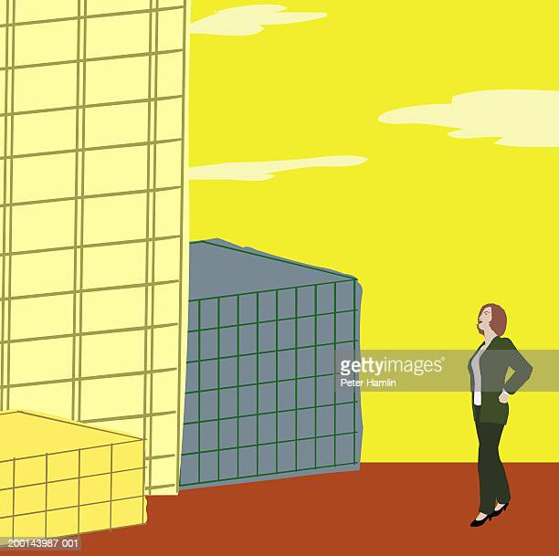 Businesswoman standing next to buildings