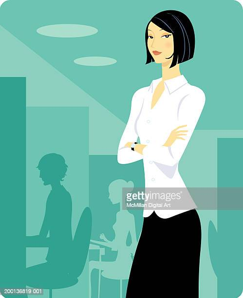 Businesswoman standing with arms folded across her chest