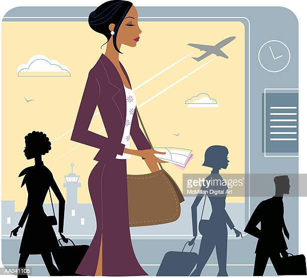 Businesswoman walking through airport, side view