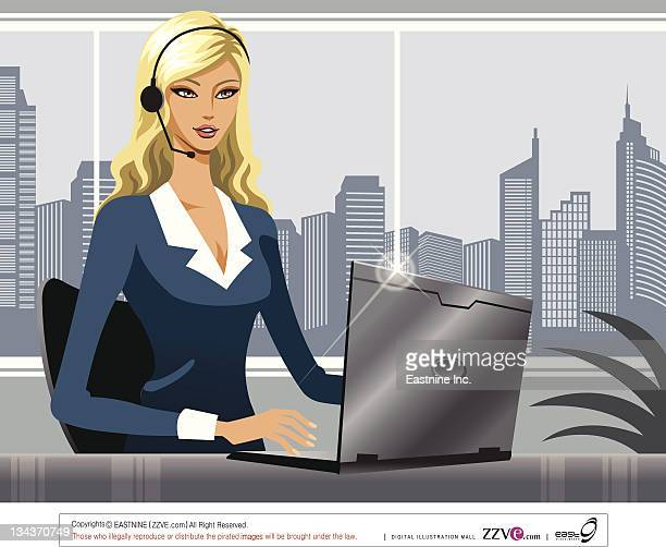 Businesswoman wearing a telephone headset with a laptop