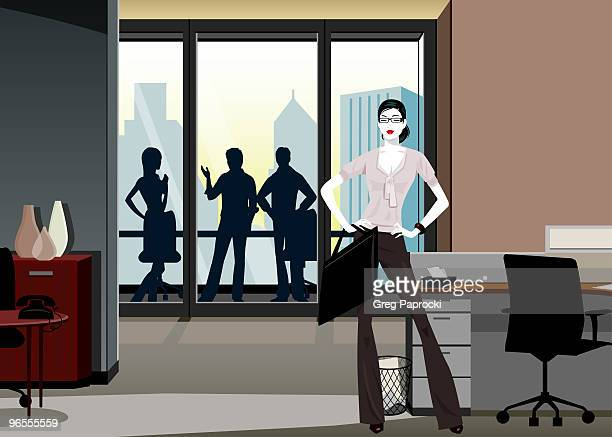 Businesswoman with briefcase standing in office