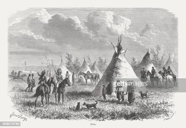 camp of the sioux, wood engraving, published in 1868 - sioux culture stock illustrations