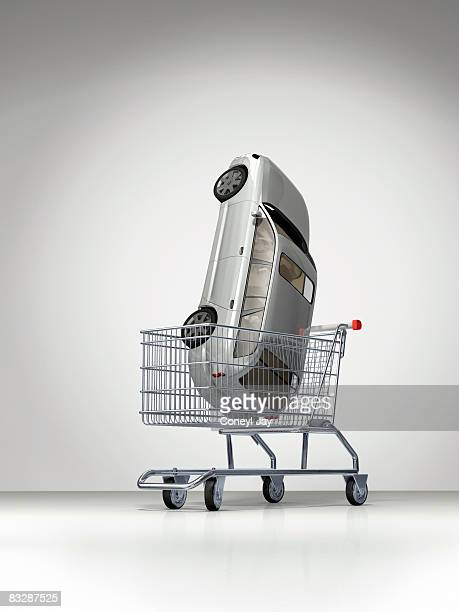 car in shopping cart - eccentric stock illustrations