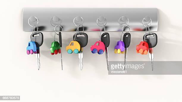 Car keys with different key ring hanging on key hook, electro car